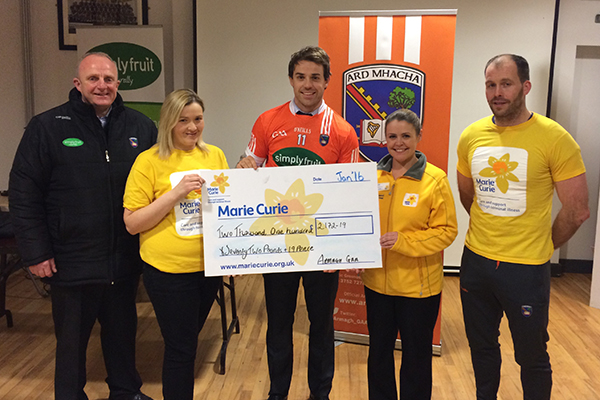 Armagh make donation to Marie Curie